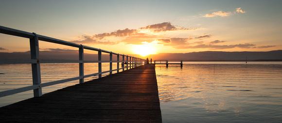 sun setting over lake illawarra