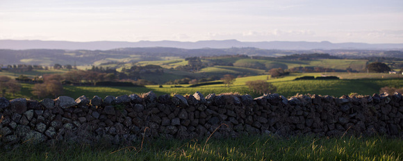 dry stone wall with rolling green hills at Saddleback Mountain